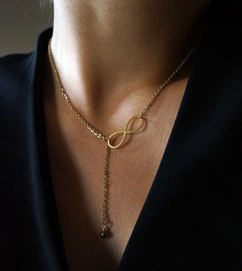 Minimal gold infinity necklace with hematite stone