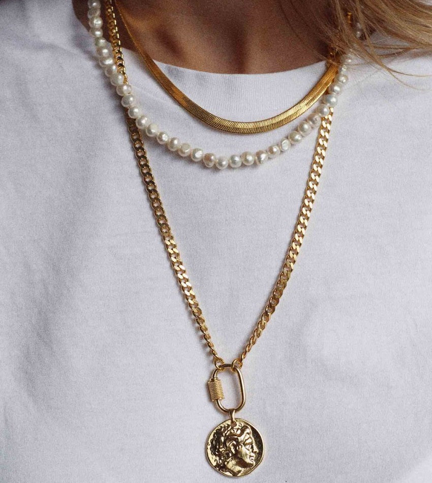 Curb chain necklace with greek coin