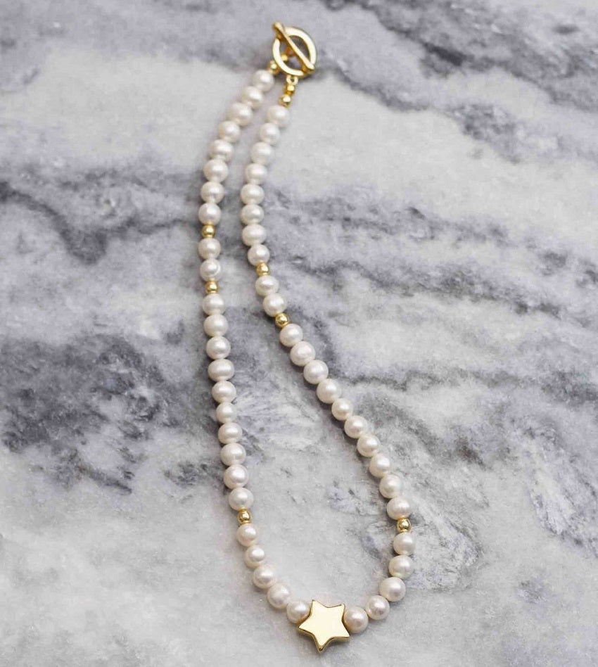 Freshwater pearls with gold star