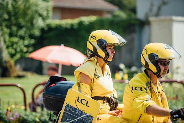The lady in yellow who rides at the front of the Tour de France