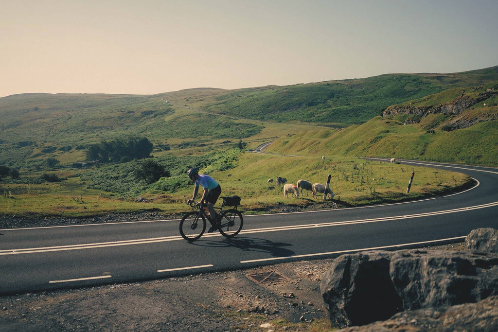 Man Cycles up Scenic Hill