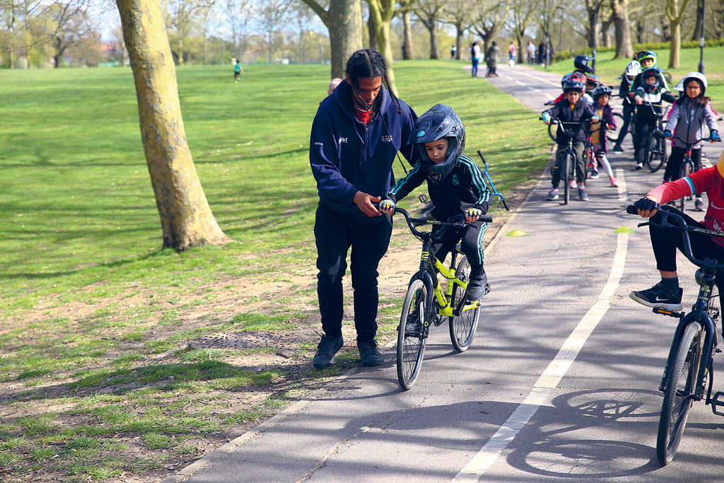 Man teaches child to cycle