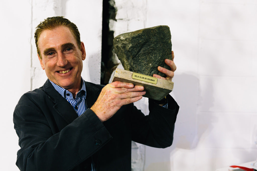 Sean Kelly holds the cobblestone trophy