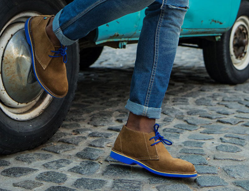 Man in blue jbay veldskoen with Jeans Veldskoen shoes ethically handcrafted genuine leather boots and shoes from South Africa  400 years of artisanship The legend becomes a fashion icon