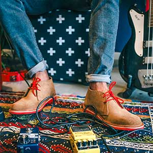 Veldskoen shoes ethically handcrafted genuine leather boots and shoes from South Africa man musician with red veldskoen genuine leather shoes