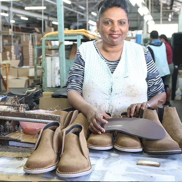 Women working on shoes in the Veldskoen factory Veldskoen shoes ethically handcrafted genuine leather boots and shoes from South Africa