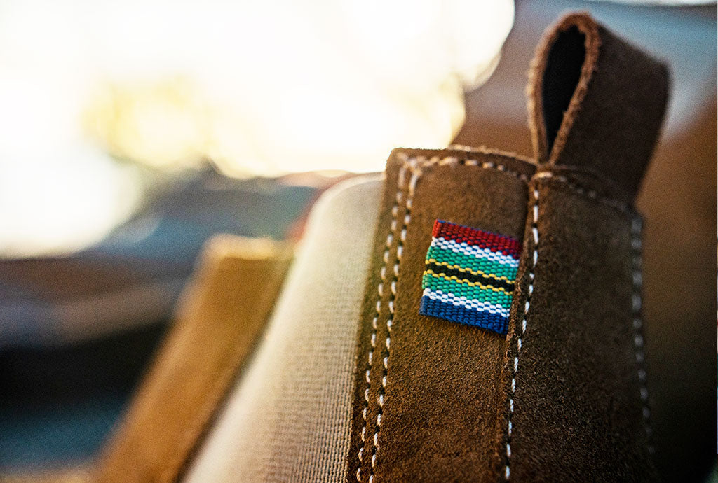 Close up of South African flag on the back on Chelsea boot by Veldskoen shoes ethically handcrafted genuine leather boots and shoes from South Africa