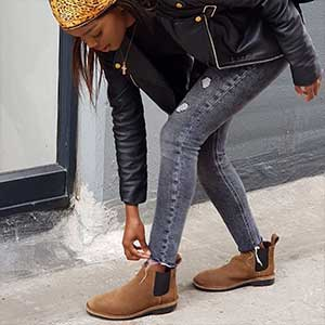 Veldskoen shoes ethically handcrafted genuine leather boots and shoes from South Africa girl in black soled chelsea boots