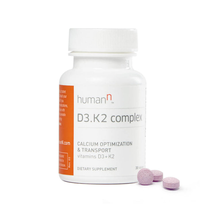 Bottle of D3.K2 complex with three tablets