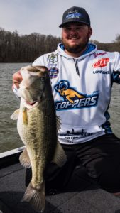 Ty Cox Blue Mountain Fishing Team On His Boat with Trohy Bass Hammer Rods