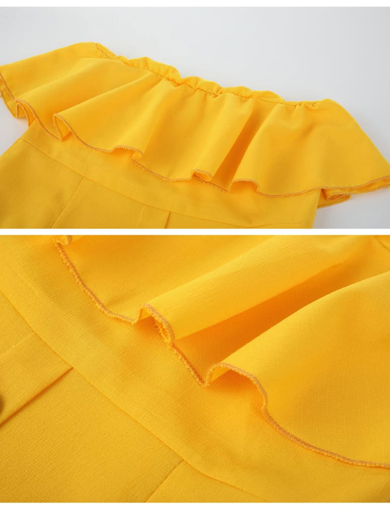 a close up of a yellow umbrella