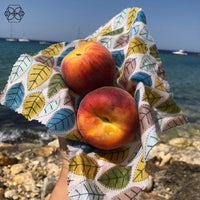 Beeswax Frank Wrap with peaches at the beach