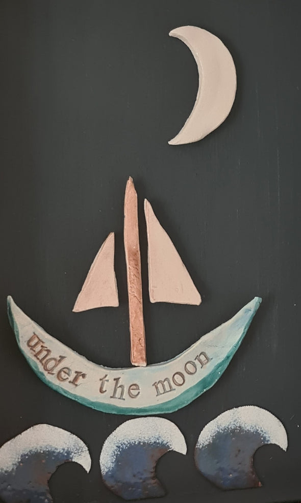Detail of ceramic boat under the moon wall art