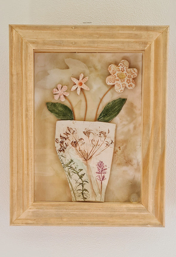 Framed ceramic pot of flowers