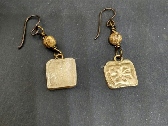 Front and back of bronze earrings