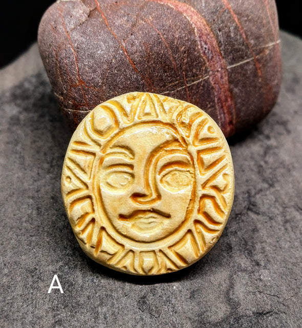 Glazed and kiln fired ceramic sun brooch