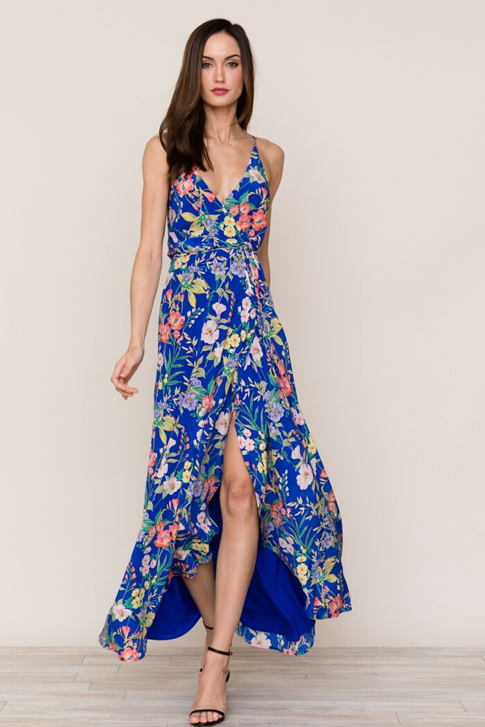 Yumi Kim's flowing Rush Hour Silk Maxi Dress is your new go-to from weddings to running around the city. The blue floral dress includes a crossover bodice with deep v-neckline.