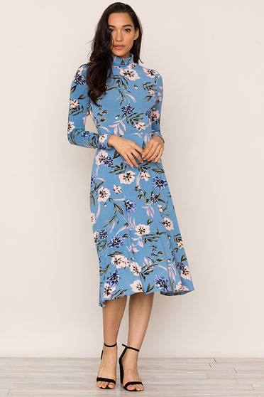 Stand out in our eye-catching Stargaze blue floral jersey Dress. Details include turtleneck bodice and a-line midi skirt.