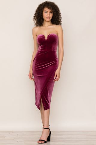 Allure Velvet Bodycon Dress by Yumi Kim. Details include luxury burgundy velvet and a sleek strapless silhouette, a bustier bodice with split v-neckline, mid-length crossover skirt.