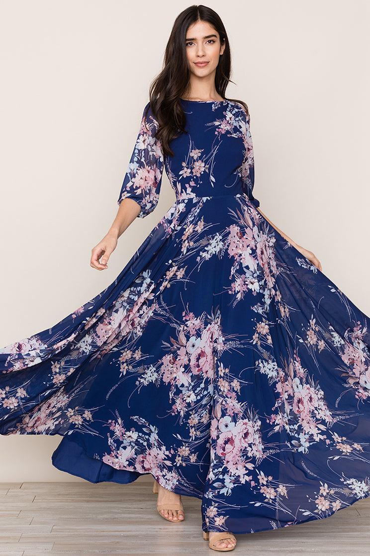 Woodstock Ladies Maxi Dress with a flowing, full-length skirt, romantic floral print and blouson sleeves by Yumi Kim.