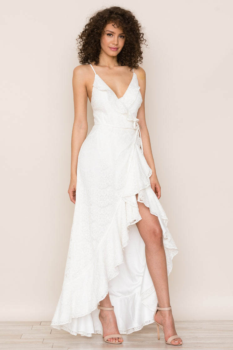 Feminine ruffle details accent the hem and neckline of Yumi Kim's wrap style Meadow Lace Ruffle White High Low Maxi Dress.