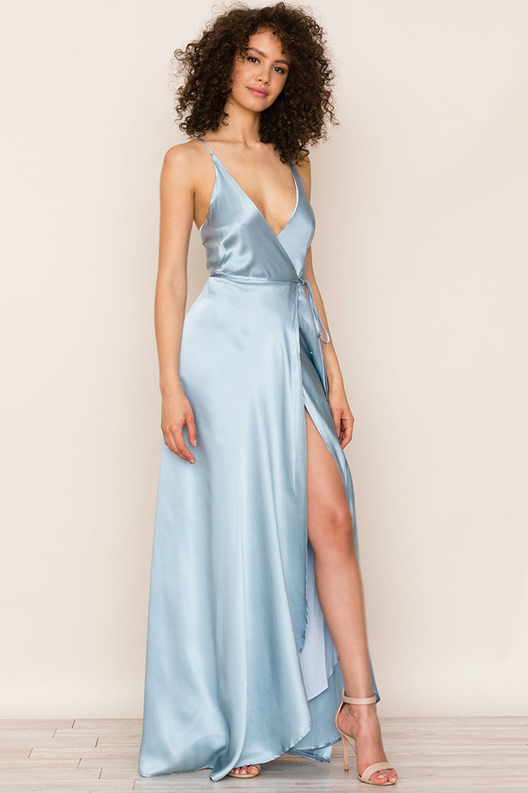 Yumi Kim's Rush Hour Blue Satin Maxi Dress is your new go-to from weddings to running around the city. This elegant wedding guest dress includes a crossover bodice with deep v-neckline.