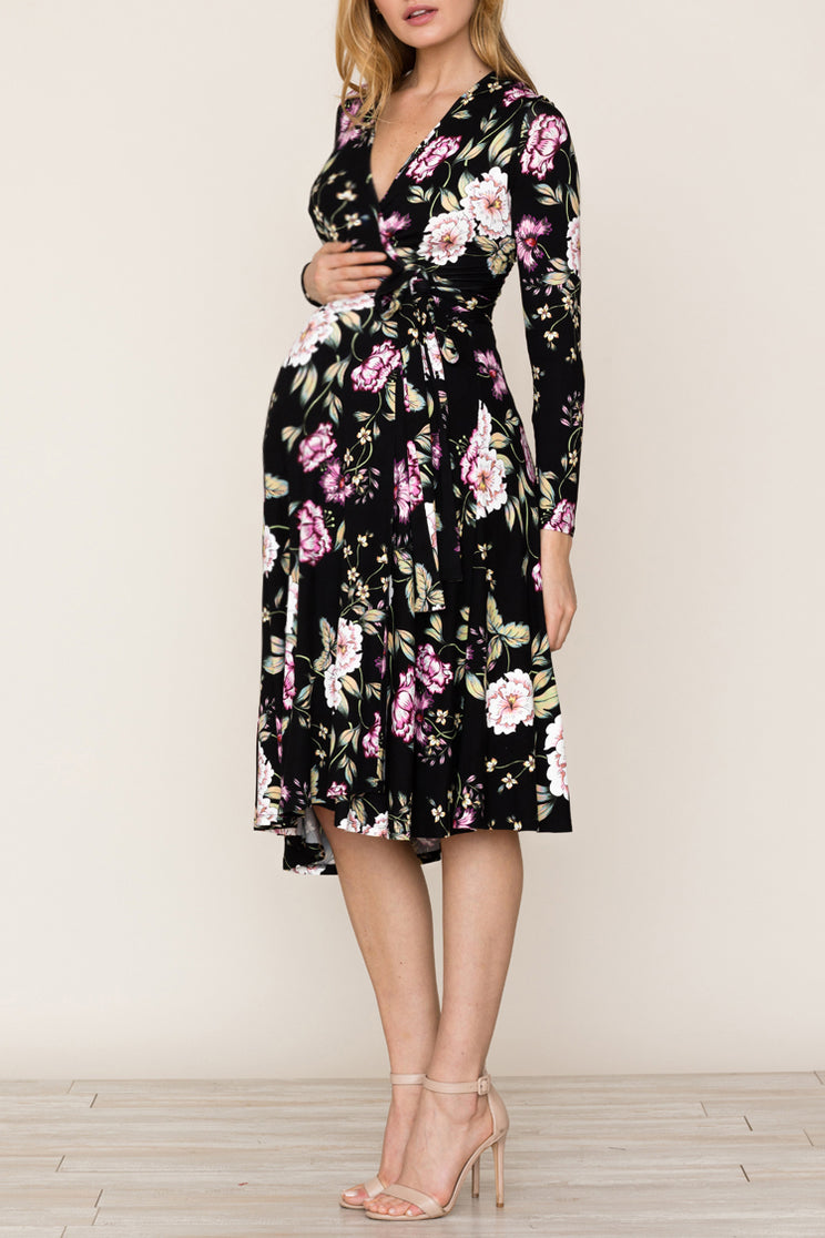 Full Circle Maternity Dress by Yumi Kim. A beautiful mid length black baby shower dress for expecting mothers. Details include self tie wrap, long sleeves and a surplice neckline.