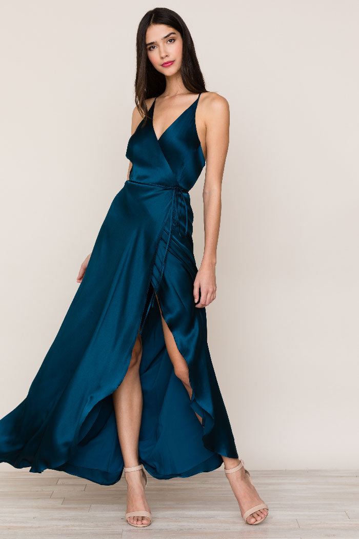 Yumi Kim's flowing Rush Hour Silk Satin Maxi Dress is your new go-to from weddings to running around the city. The wrap maxi dress includes a crossover bodice with deep v-neckline.