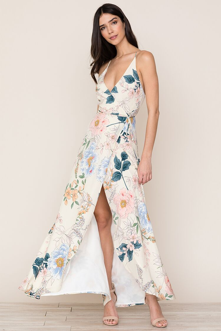 Yumi Kim's flowing Rush Hour Silk Maxi Dress in Rainforest Ivory is your new go-to from weddings to running around the city. The floral dress includes a crossover bodice with deep v-neckline, snap chest closure, self-tie waist, and cross-back adjustable s