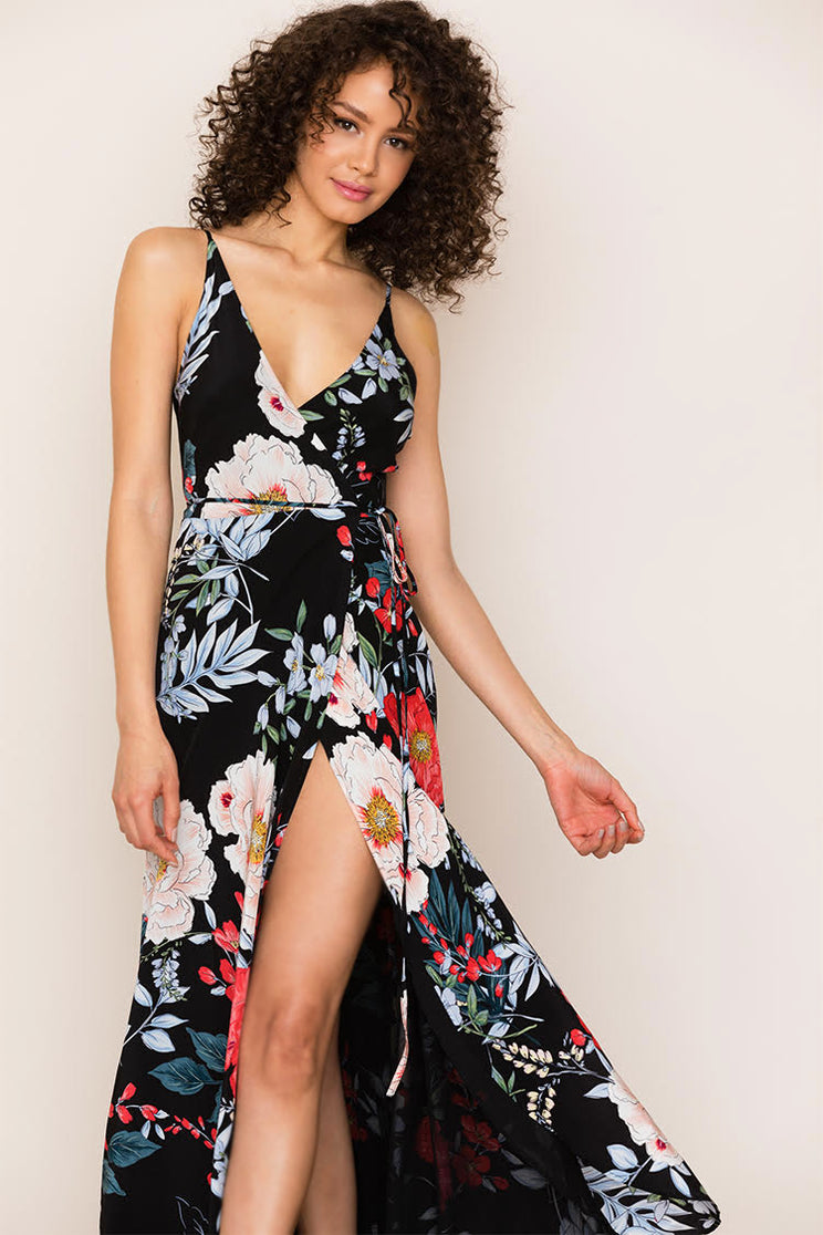 Yumi Kim's flowing Rush Hour Silk Floral Maxi Dress in black is your new go-to from weddings to running around the city. The floral dress includes a crossover bodice with deep v-neckline.