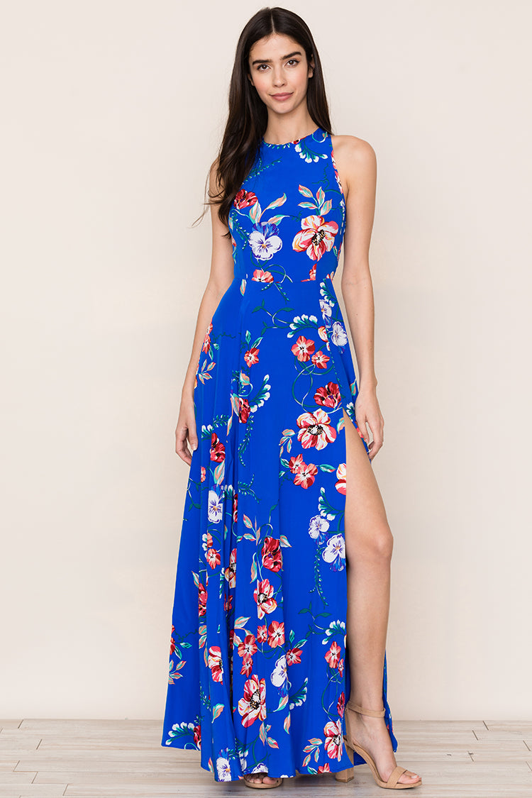 Yumi Kim's eye-catching Dream Silk Maxi features a bold floral print and long flowing skirt with a thigh high slit. Details include a fitted waist, racer back top, and hidden back zip.