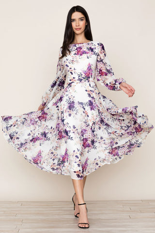A romantic purple floral print complements the elegant, bohemian feel of Serenade Floral Midi Dress by Yumi Kim. Details include midi length, full skirt, full blouson sleeves, and hidden back zip.