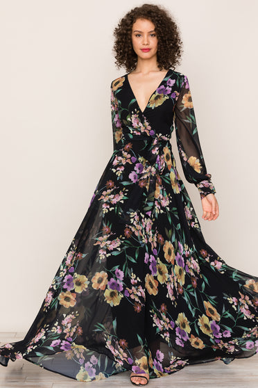Meet the elegant, flowing silhouette of Yumi Kim's Giselle Floral Maxi Dress. Details include long sleeves, attached belt, a wrap bodice, buttons on cuff, snap closure on neckline, and hidden back zipper.