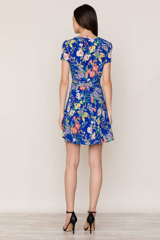Meet The floral print Kennedy Silk Wrap Dress by Yumi Kim. This versatile mini wrap dress will become a staple in your closet. Details include a flattering crossover neckline, self-tie waist, and hidden snap chest closure.