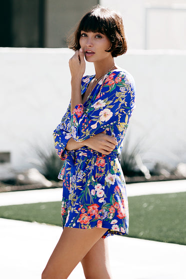 Meet Liz Silk Romper by Yumi Kim. A classy yet playful closet must-have blue floral romper that creates a chic alternative to the dress. Details include a cross over v-neck with a hidden snap closure and side pockets.
