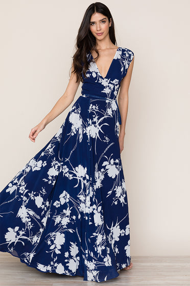 Achieve effortless elegance with Yumi Kim's Sashay Away navy floral maxi dress. Details include full sweeping skirt, a self-tie waist, and snap chest closure. Fully lined.