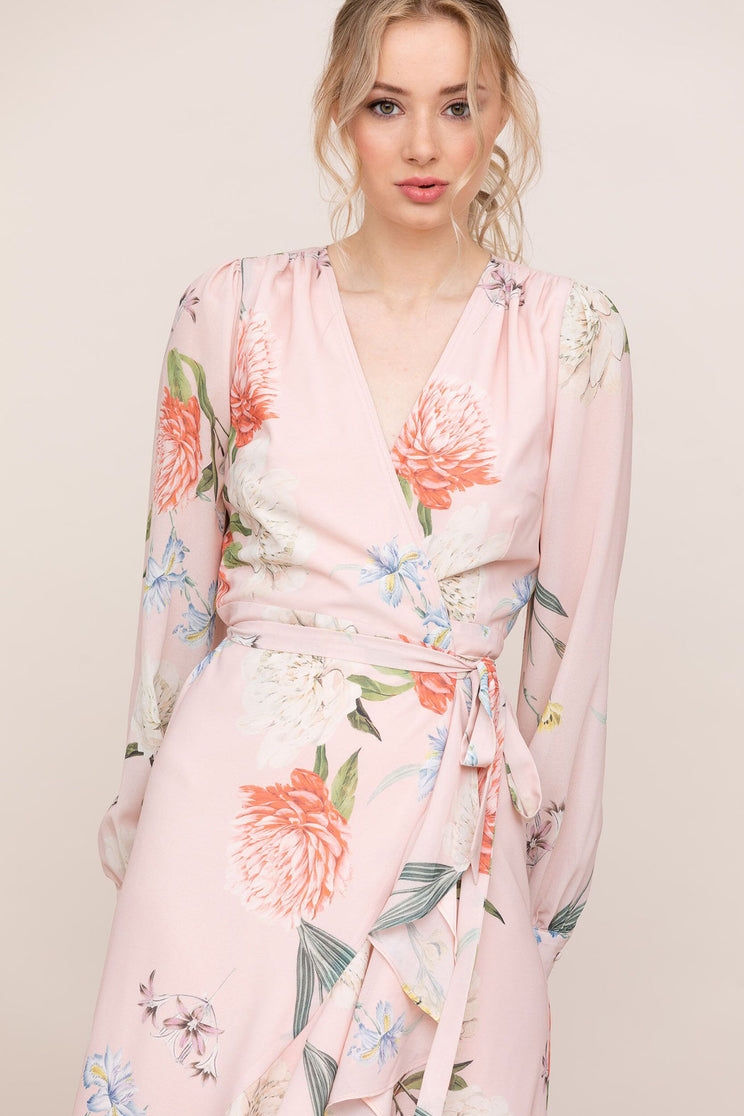 Long blouson sleeves and mid-length skirt with ruffle trim gives Yumi Kim's Casanova Pink Floral Wrap Dress an elegant look.
