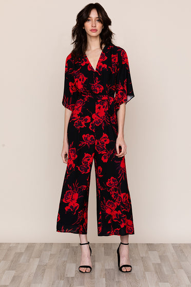Make a retro statement in Yumi Kim's High Voltage Black Floral Jumpsuit.