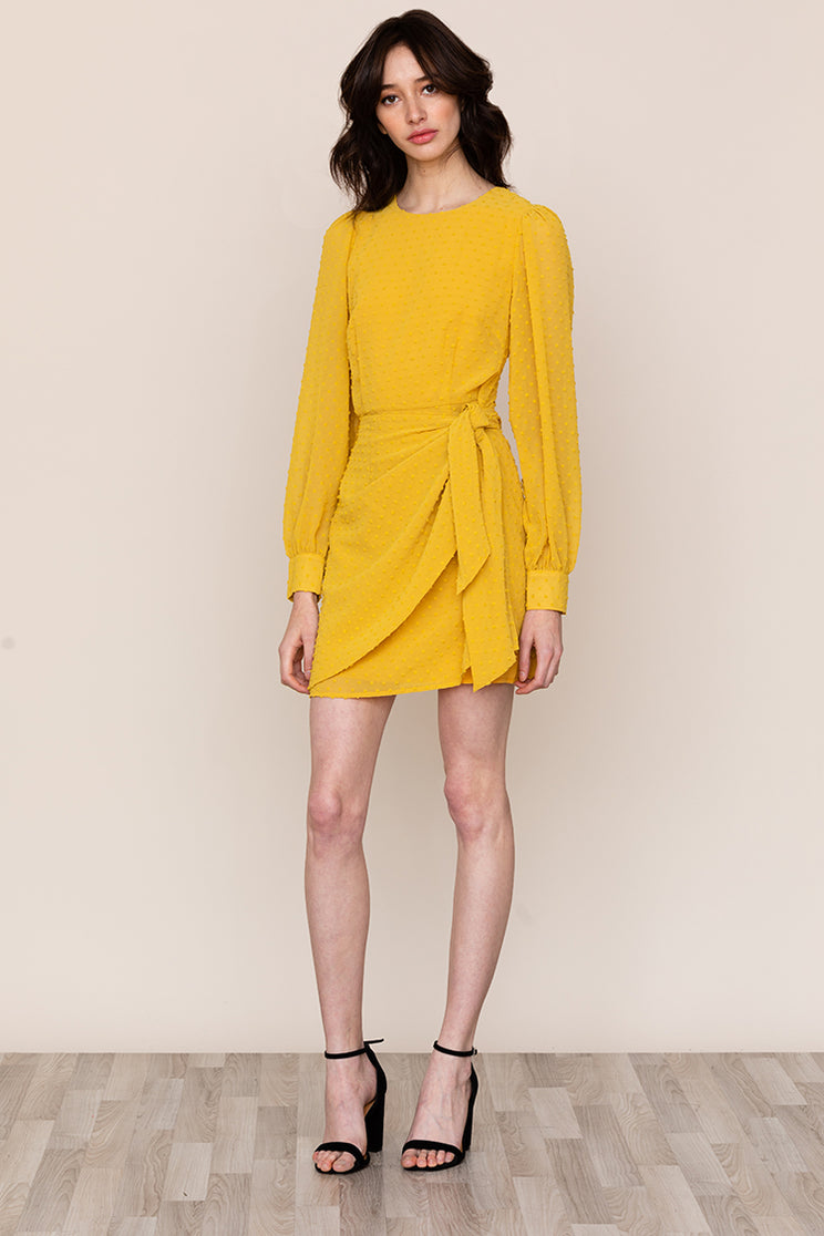 Yumi Kim's simple, yet classy Wonderland Yellow Wrap Mini dress checks all the boxes.