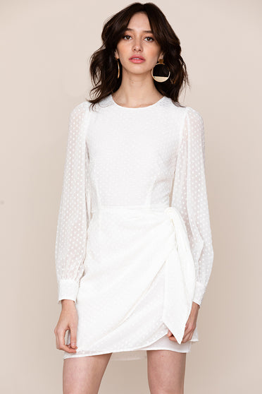 Yumi Kim's simple, yet classy Wonderland white long-sleeve mini dress checks all the boxes.