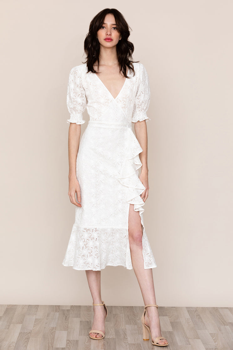 Step up your lace game in Savannah White Lace Midi Dress by Yumi Kim.