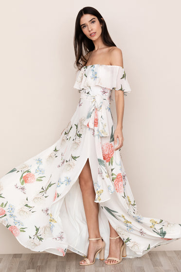Yumi Kim's ruffled off-the-shoulder Carmen Floral Maxi Dress is a bold statement piece.