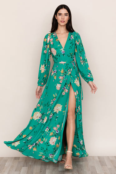 A full skirt complements the elegant, flowing silhouette of Yumi Kim's Juliette Green Floral Maxi Dress.