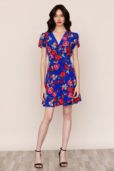 Meet The floral print Kennedy Silk Wrap Dress. This versatile mini wrap dress will become a staple in your closet.