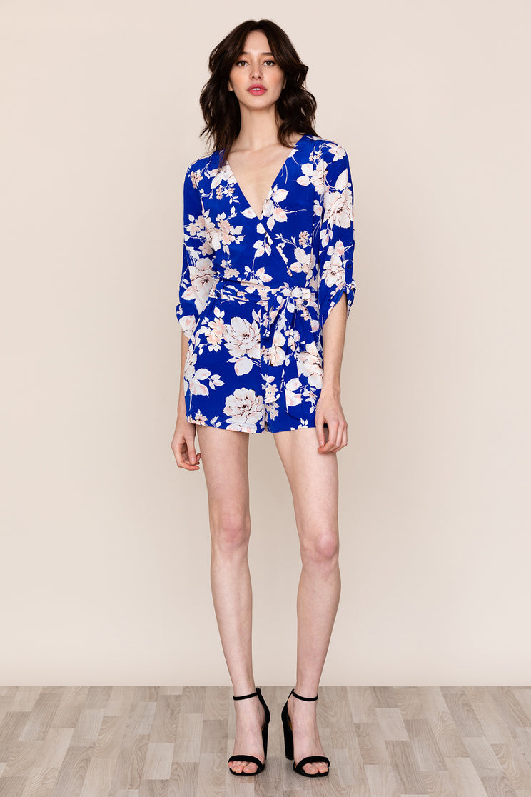 A classy yet playful closet must-have blue floral silk romper that creates a chic alternative to the dress.