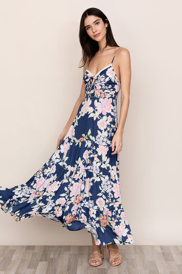 Yumi Kim's Key West Maxi is the floral spaghetti strap dress you will never want to take off. Details include adjustable straps, back smocking, front self tie key hole, and drop waist.