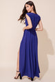 Swept Away Wrap Maxi dress with elegant navy, a thigh-high slit, a tie waist and snap chest closure by Yumi Kim.