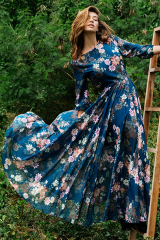 Woodstock Ink Floral Maxi Dress with a flowing, full-length skirt, romantic floral print and blouson sleeves by Yumi Kim.