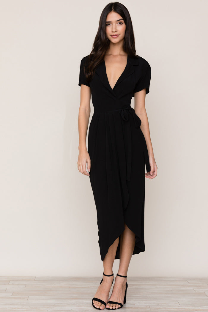 Yumi Kim's refined Meet and Greet black midi wrap dress is a staple in every closet. Details include collared v-neck, self tie waist and midi length.