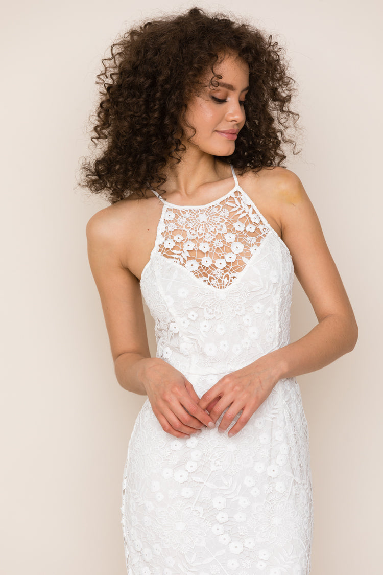 Yumi Kim's She's Mine White Lace Cocktail Dress for parties. Details include a sophisticated midi length, with unlined V detail at neck, and back slit.